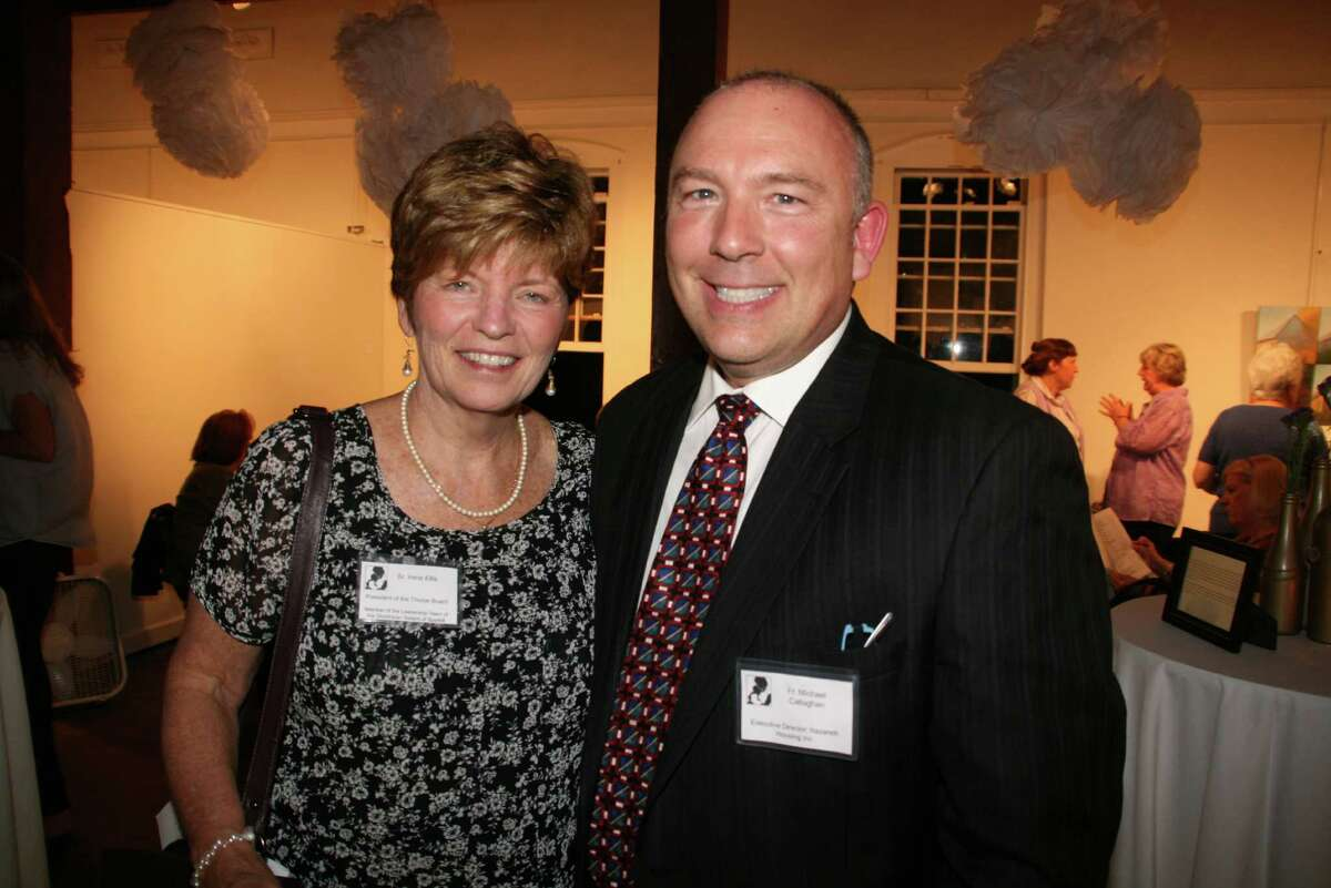 Irene Ellis, President of the Board, Thorpe Family Residence and Michael Callaghan, C.O., Executive Director, Thorpe Family Residence at the 25th anniversary gala at the New Canaan Carriage Barn. October 5, 2013. New Canaan, Conn.