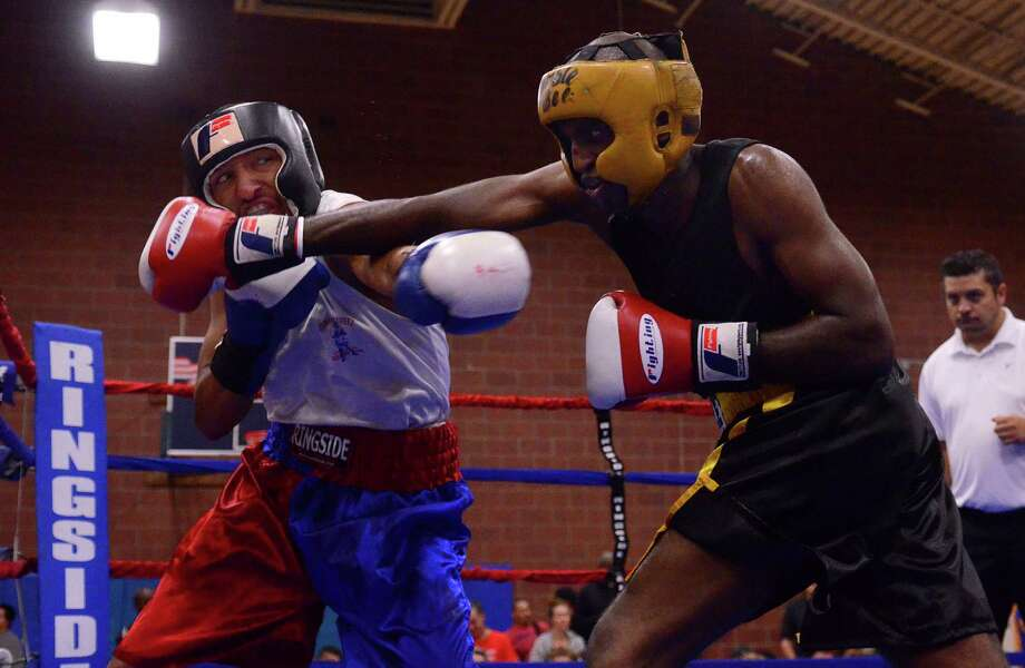 Antonio Tessatore from the Howard Street Boxing Club, left, fights Robel Biru from the Bumble Bee Boxing Club during the 4th annual Central District Boxing Revival Saturday, Oct. 5, 2013 at the Garfield Community Center in Seattle. Boxers from all over the Northwest region, ranging from ages 8-34, competed in Saturday's event. Photo: SY BEAN, SEATTLEPI.COM / SEATTLEPI.COM