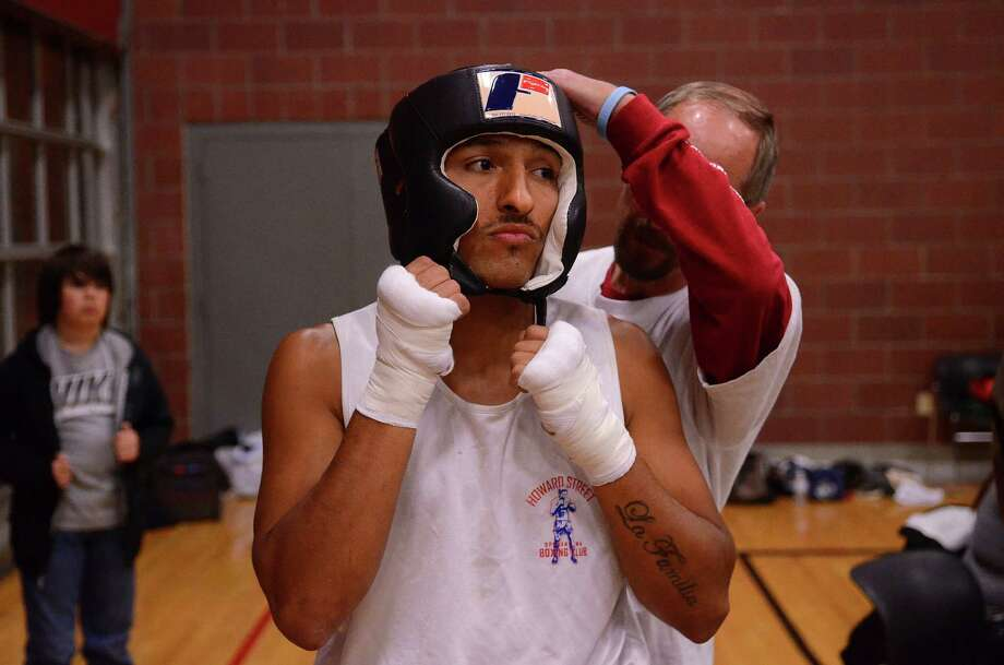 Antonio Tessatore from the Howard Street Boxing Club prepares for his fight against Robel Biru from the Bumble Bee Boxing Club during the 4th annual Central District Boxing Revival Saturday, Oct. 5, 2013 at the Garfield Community Center in Seattle. Boxers from all over the Northwest region, ranging from ages 8-34, competed in Saturday's event. Photo: SY BEAN, SEATTLEPI.COM / SEATTLEPI.COM