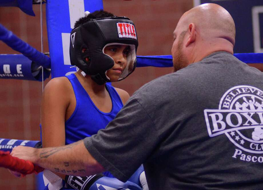 Jacob Ochoa Aquilar, 11, is coached by his father, David, during the 4th annual Central District Boxing Revival Saturday, Oct. 5, 2013 at the Garfield Community Center in Seattle. Jacob has only competed in two matches. Photo: SY BEAN, SEATTLEPI.COM / SEATTLEPI.COM