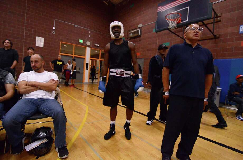 Boxers from all over the Northwest region, ranging from ages 8-34, competed in the 4th annual Central District Boxing Revival Saturday, Oct. 5, 2013, at the Garfield Community Center in Seattle. Photo: SY BEAN, SEATTLEPI.COM / SEATTLEPI.COM