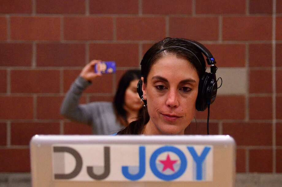 DJ Joy provided the music during the 4th annual Central District Boxing Revival Saturday, Oct. 5, 2013 at the Garfield Community Center in Seattle. Photo: SY BEAN, SEATTLEPI.COM / SEATTLEPI.COM