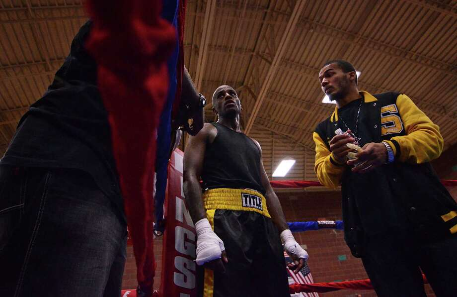 Robel Biru from the Bumble Bee Boxing Club stands in his corner after fighting Antonio Tessatore during the 4th annual Central District Boxing Revival Saturday, Oct. 5, 2013 at the Garfield Community Center in Seattle. Boxers from all over the Northwest region, ranging from ages 8-34, competed in Saturday's event. Photo: SY BEAN, SEATTLEPI.COM / SEATTLEPI.COM
