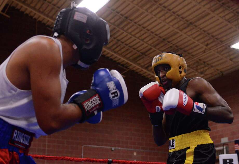 Robel Biru from the Bumble Bee Boxing Club fights Antonio Tessatore from the Howard Street Boxing Club during the 4th annual Central District Boxing Revival Saturday, Oct. 5, 2013 at the Garfield Community Center in Seattle. Boxers from all over the Northwest region, ranging from ages 8-34, competed in Saturday's event. Photo: SY BEAN, SEATTLEPI.COM / SEATTLEPI.COM