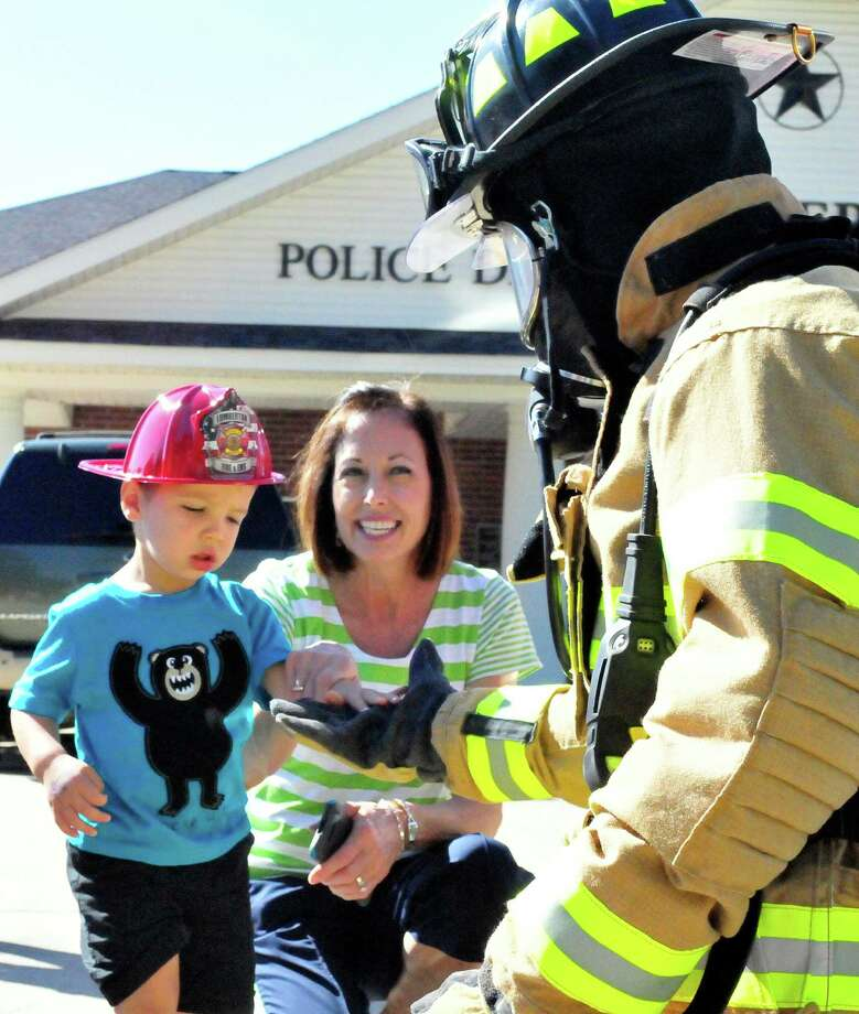 The Lumberton Fire & EMS visited children at the Public Library on Oct. 9 to discuss fire safety. The children got the chance to sit inside a fire truck. A firefighter dressed in full gear and encouraged the children to shake his hand, in an effort to remind them that the firefighter is not scary in uniform. Photo: Cassie Smith