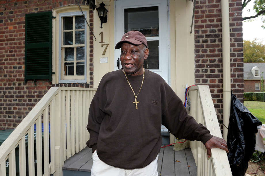 James Brown stands on the front steps of his home in the Seaside Village neighborhood of Bridgeport, Conn., Oct. 9, 2013. BrownâÄôs home, and others in the neighborhood, were flooded and damaged during storm Sandy last year, and have been cleaned up and renovated with grant funds from the Robin Hood Foundations. Photo: Ned Gerard / Connecticut Post
