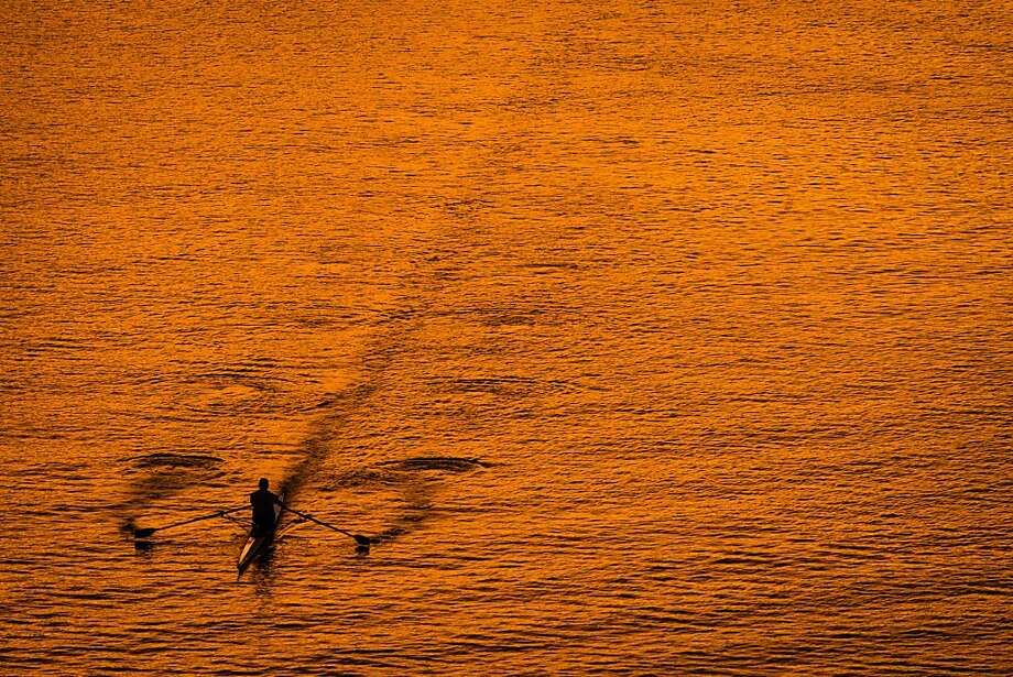 Back-to-scull day: A rower skims across the surface of the Potomac River at sunset in Washington. Photo: J. David Ake, Associated Press