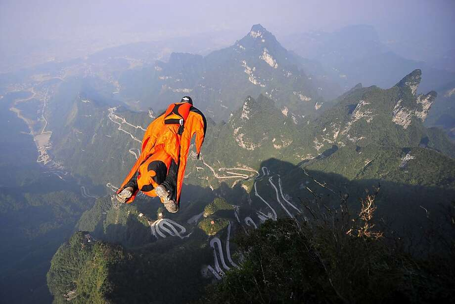 Tragic leap: Hungarian wingsuit flier Viktor Kovats jumps off a cliff in China's Tianmen Mountain National Forest Park shortly before crashing into rocks on his descent. His body was recovered from steep, forested terrain in the valley below. Kovats, who was highly experienced in the daredevil sport, was practicing for the second World Wingsuit Championship this weekend. Photo: Associated Press