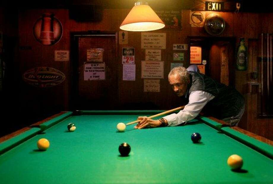 Angie's Tavern: Police considered this Columbia City dive bar a trouble spot, but regulars found it a welcoming refuge from a gentrifying neighborhood. Pictured here is Ted Cook shooting pool in 2007. Photo: Dan DeLong, Seattle Post-Intelligencer / Seattle Post-Intelligencer