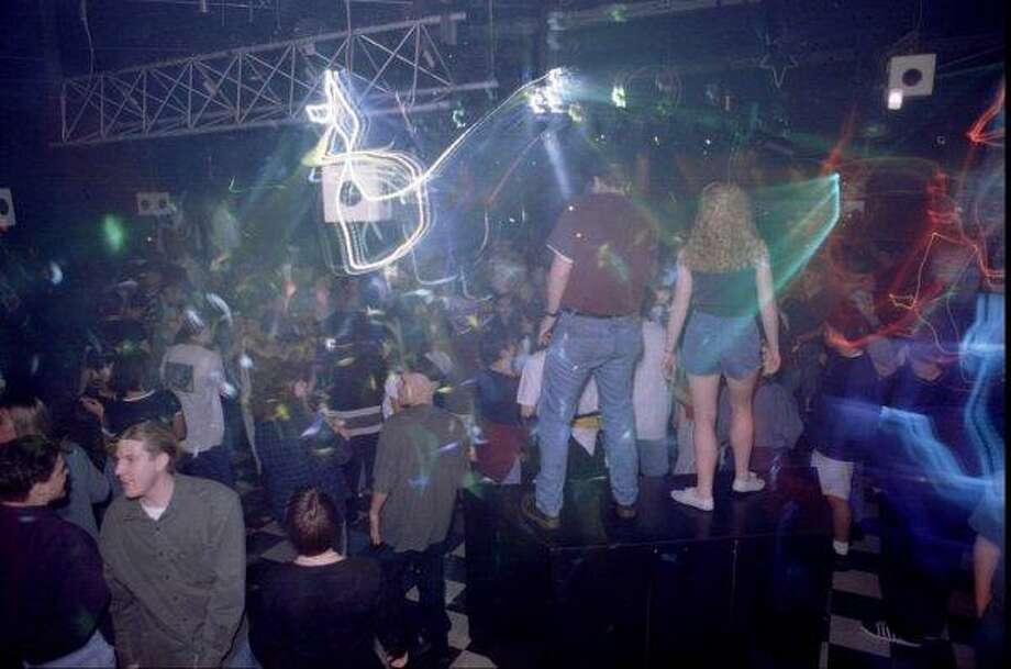 If you grew up in Seattle, you might have hit DV8, an under-21 dance club. It's pictured here in this 1995 photo, when people in not exactly swanky clothes felt okay dancing in full view of everyone. Photo: P-I File / P-I file