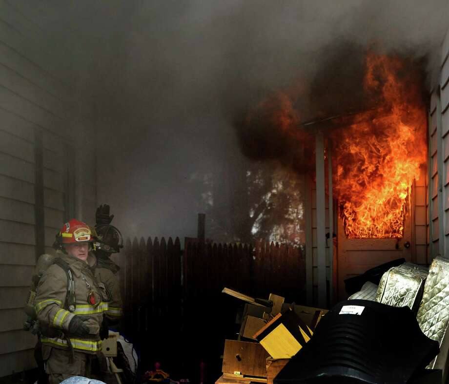 Firefighters work to knock down a stubborn fire at 22 Mynderse Street Wednesday afternoon Oct. 9, 2013 in Schenectady, N.Y.  Chief Michael DellaRocco received burns to his hand which was the only injury at the scene.  The occupants all evacuated safely.      (Skip Dickstein / Times Union) Photo: Skip Dickstein