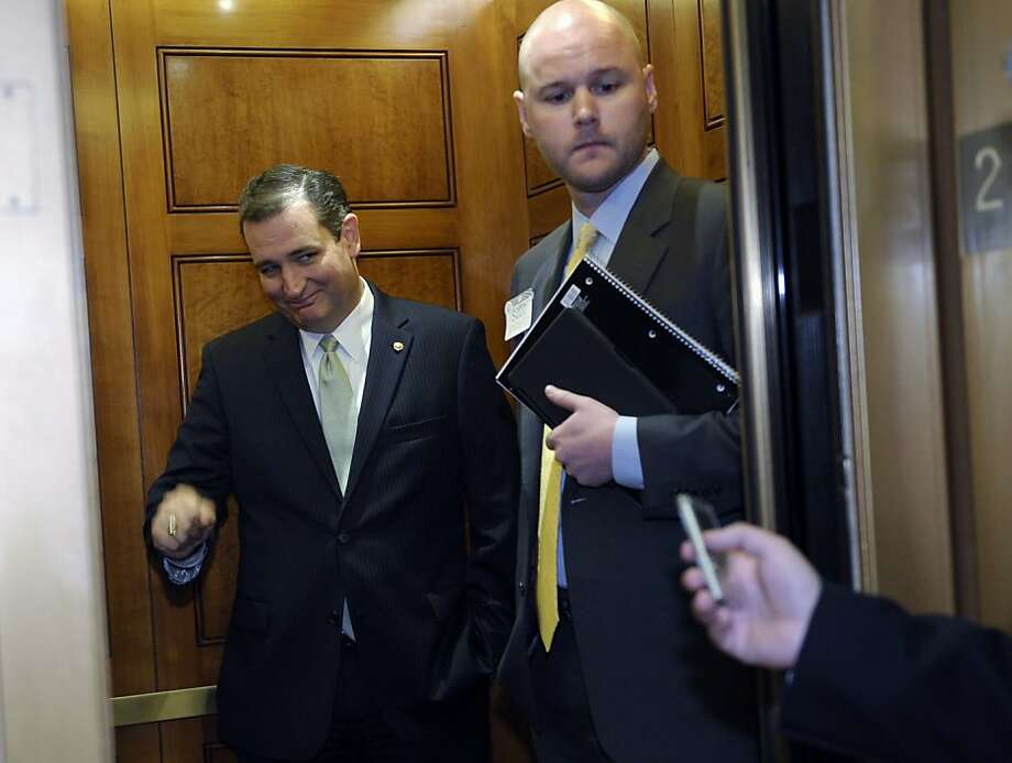 Sen. Ted Cruz, R-Texas, left, gets into an elevator following a vote on Capitol Hill in Washington, Wednesday, Oct. 9, 2013. President Barack Obama is making plans to talk with Republican lawmakers at the White House in the coming days as pressure builds on both sides to resolve their deadlock over the federal debt limit and the partial government shutdown.  (AP Photo/Susan Walsh) Photo: Susan Walsh, Associated Press