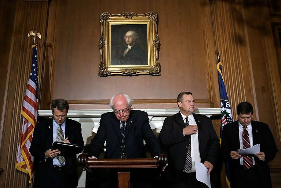 Sens. Sherrod Brown (left), Bernie Sanders, John Tester and Mark Begich, discusses the shutdown's effects on veterans. Photo: Win McNamee, Getty Images