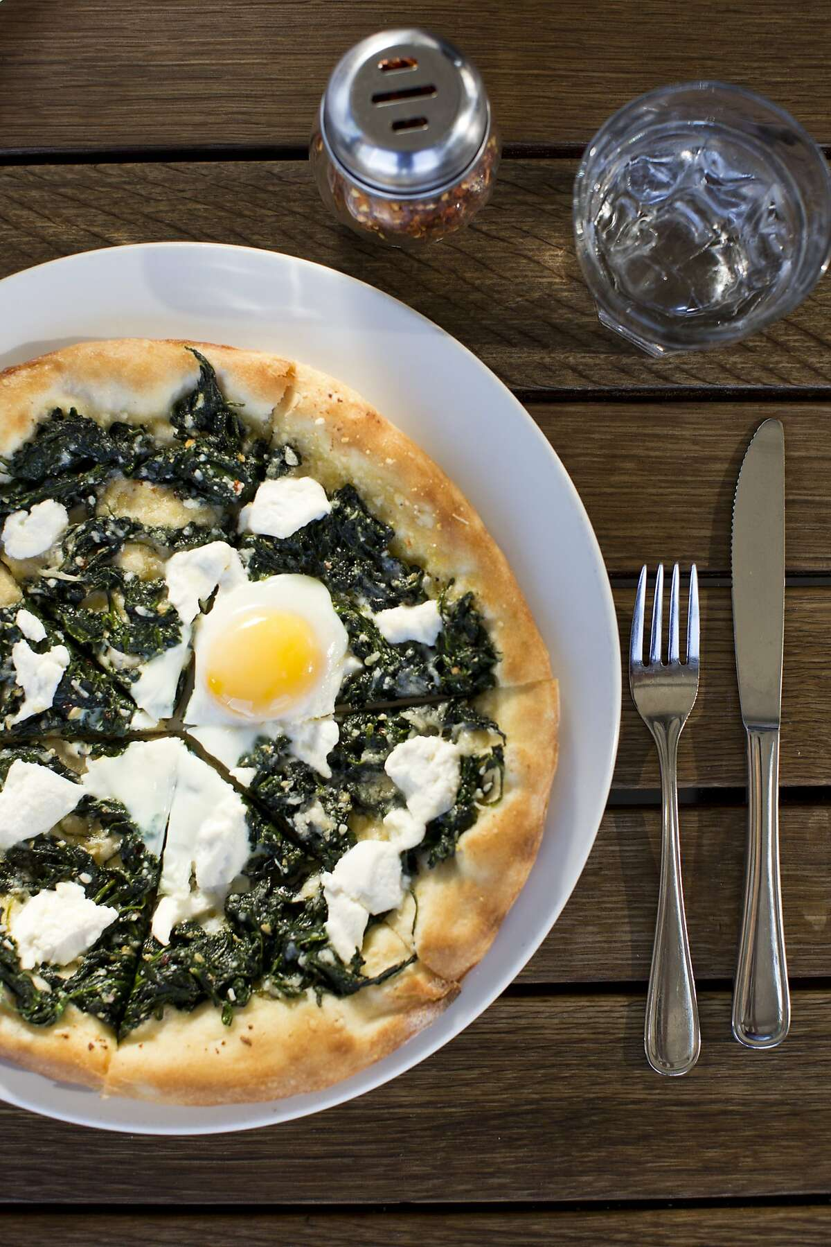 A Verde pizza with spinach, garlic, chilies & ricotta at Azzurro Pizzeria e Enoteca in Napa, Calif., Wednesday, October 2, 2013.