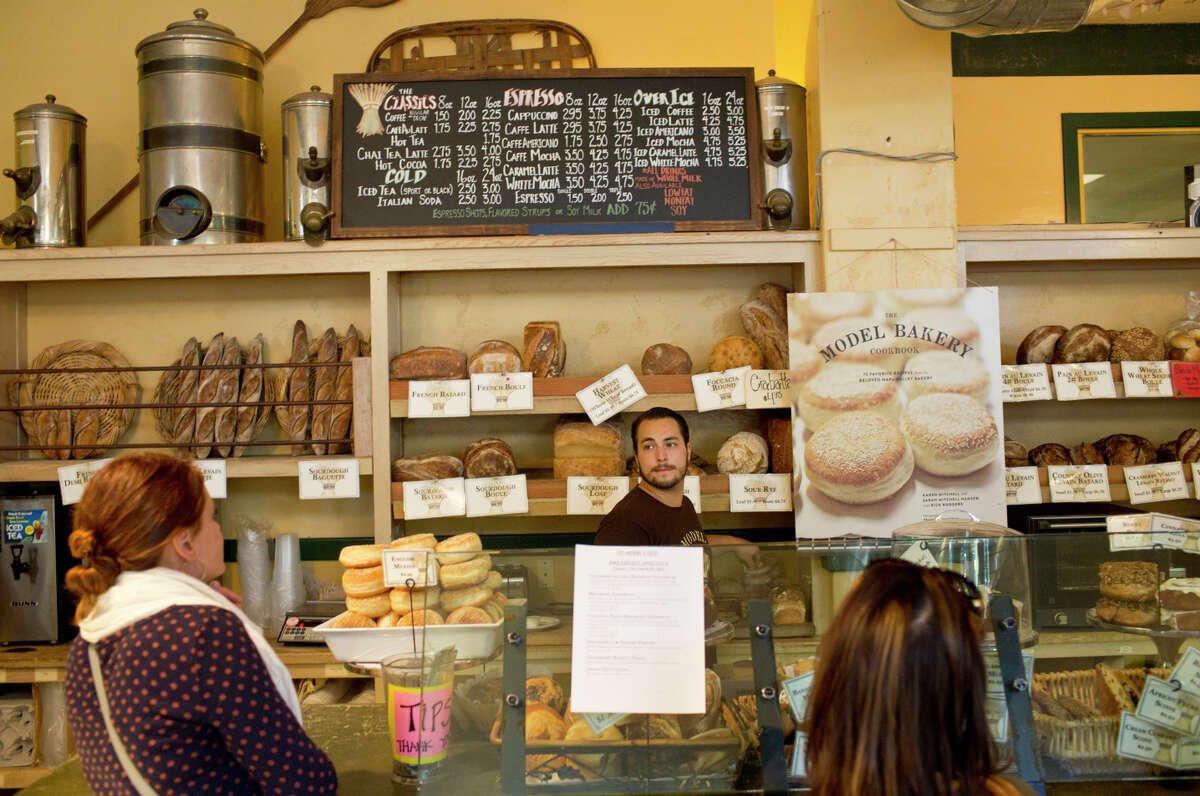 Kenji O'Sullivan helps customers at Model Bakery in St. Helena, where the English muffin is so highly coveted, there's a limit of six per customer.