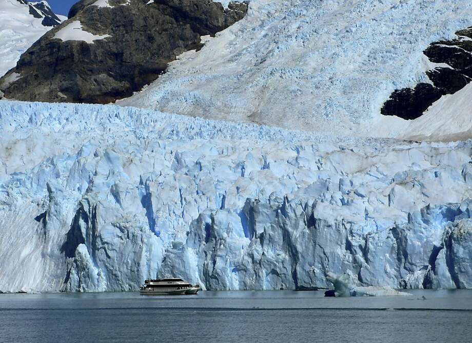 FILE - This Wednesday, Feb. 23, 2011 file photo shows a tour boat as it passes near the snout of Spegazzini Glacier in Los Glaciares National Park in Argentina. There are dozens of glaciers in the area fed by the Southern Patagonian Ice Field, which blankets a wide swath of the Andes between Chile and Argentina. Just how to define a glacier is at the heart of a Chilean congressional battle that could determine the future of mining in the worldís largest copper-producing country. (AP Photo/Ian James, File) Photo: Ian James, Associated Press