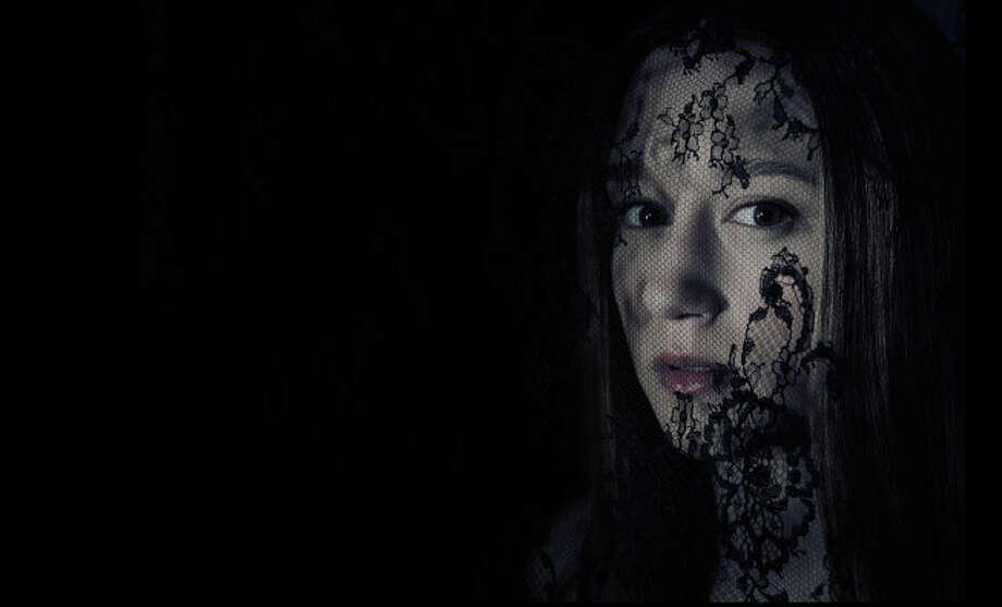 AMERICAN HORROR STORY: COVEN -- Pictured: Taissa Farmiga as Zoe -- CR: Frank Ockenfels/FX