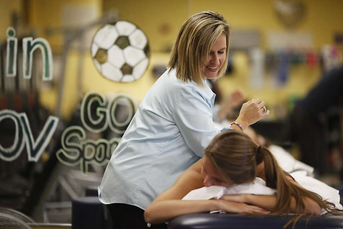 Robin Bousquet works on Kelly Furay's back during an appointment at Sports Medicine for Young Athletes in Walnut Creek, Calif. on Sunday, Sept. 23, 2013. Bousquet is a senior physical therapist who specializes in youth athletes.