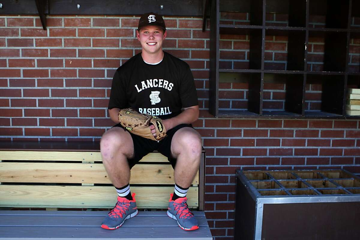 St. Francis high school senior Blake Billinger sits at his school's dugout in Mountain View, California as he talks about baseball on Wednesday, September 4, 2013.