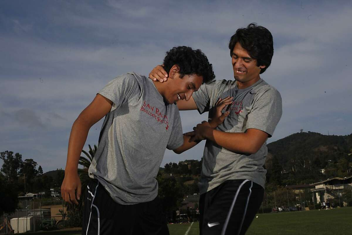 Soccer players Alex Argueta, sophomore, left and his brother Daniel Argueta, senior, at San Rafael High School practice, Wednesday September 11, 2013, in San Rafael, Calif.