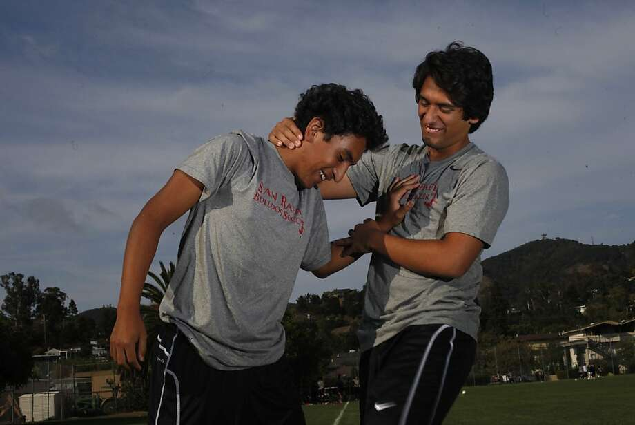 Sophomore Alex Argueta and his brother Daniel, a senior, horse around at San Rafael High School soccer practice. Photo: Lacy Atkins, The Chronicle