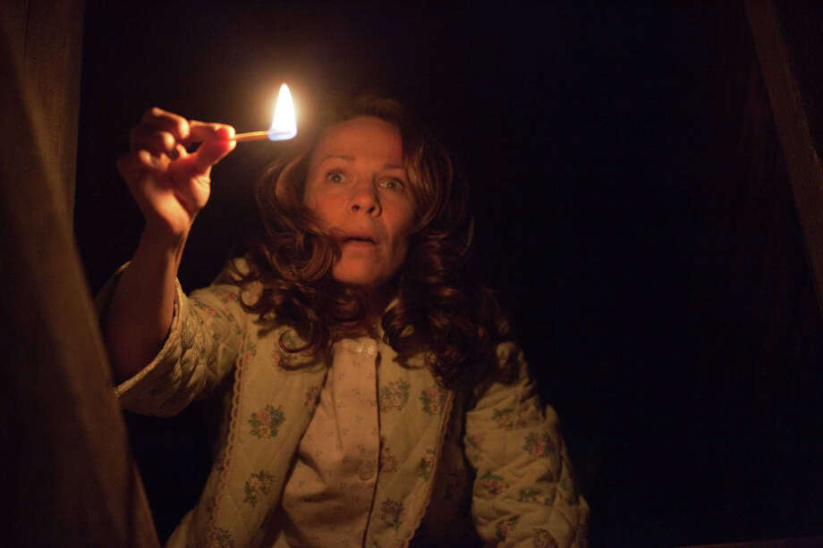 "31. ""The Conjuring"" (2013): The New Yorker called this creepy farmhouse movie ""a small Hitchcockian symphony of terror by way of long, eerier tracking shots, dramatic silences, and sudden scares that are frighteningly immersive."" With Lili Taylor, pictured, Vera Farmiga and Patrick Wilson. Photo: Michael Tackett, AP / New Line Cinema/Warner Bros. Pictures"