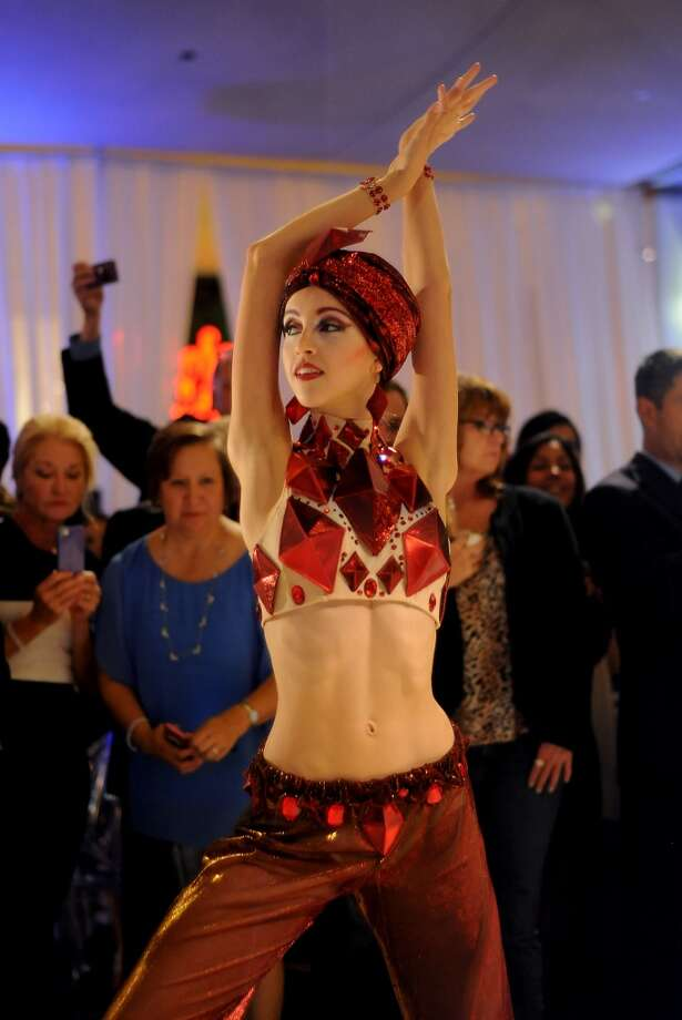 Dancers show off the new costumes during a routine at the Houston Ballet Ball Kick-Off party over the ice rink at the Galleria Tuesday Oct. 08,2013.(Dave Rossman photo) Photo: For The Houston Chronicle