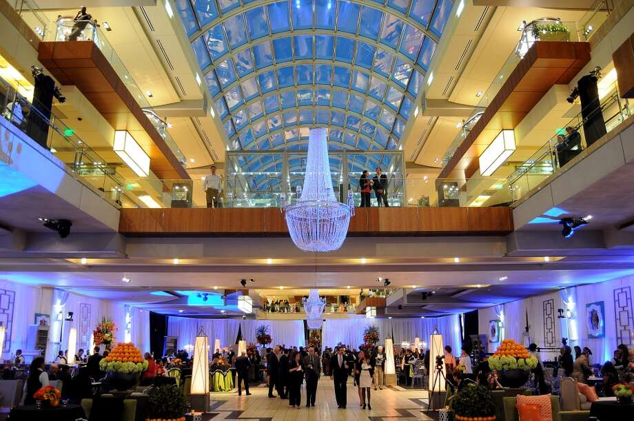 Guests enter the Houston Ballet Ball Kick-Off party over the ice rink at the Galleria Tuesday Oct. 08,2013.(Dave Rossman photo) Photo: For The Houston Chronicle