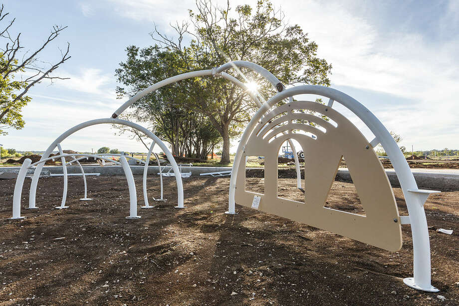 Sunlight sparkles on climbing equipment at the new Bulverde Community Park on Tuesday, waiting for kids who want to play. Work on the $1.6 million park, covering more than 12 acres bordering on Bulverde Lane, is expected to be completed in November. Photo: Marvin Pfeiffer / Prime Time New