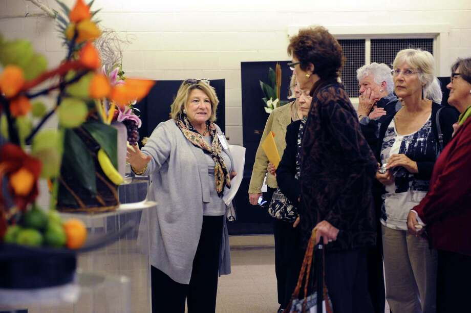 "Melinda Wolcott, of Wilton, judging arrangements at the ""50 Shades of....Gardening"", a small standard flower show, at Eastern Greenwich Civic Center, in Old Greenwich, Conn., Wednesday Oct, 9, 2013. The show was presents by Knollwood Garden Club, Riverside Garden Club and the Garden Club of Old Greenwich. Photo: Helen Neafsey / Greenwich Time"