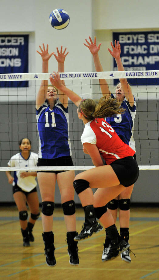 Darien's Claire Naughton, left, and Izzy Taylor attempt to block the shot of Greenwich's Heather Desino during their game at Darien High School in Darien, Conn., on Wednesday, Oct. 9, 2013. Greenwich won, 3-1. Photo: Jason Rearick / Stamford Advocate