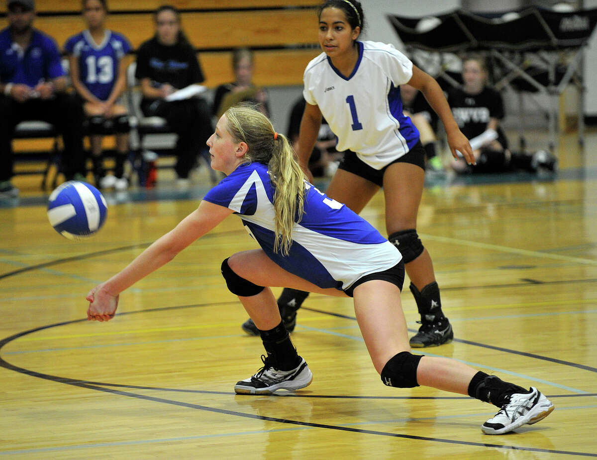 Darien's Izzy Taylor makes a dig during the Blue Wave's game against Greenwich at Darien High School in Darien, Conn., on Wednesday, Oct. 9, 2013. Greenwich won, 3-1.
