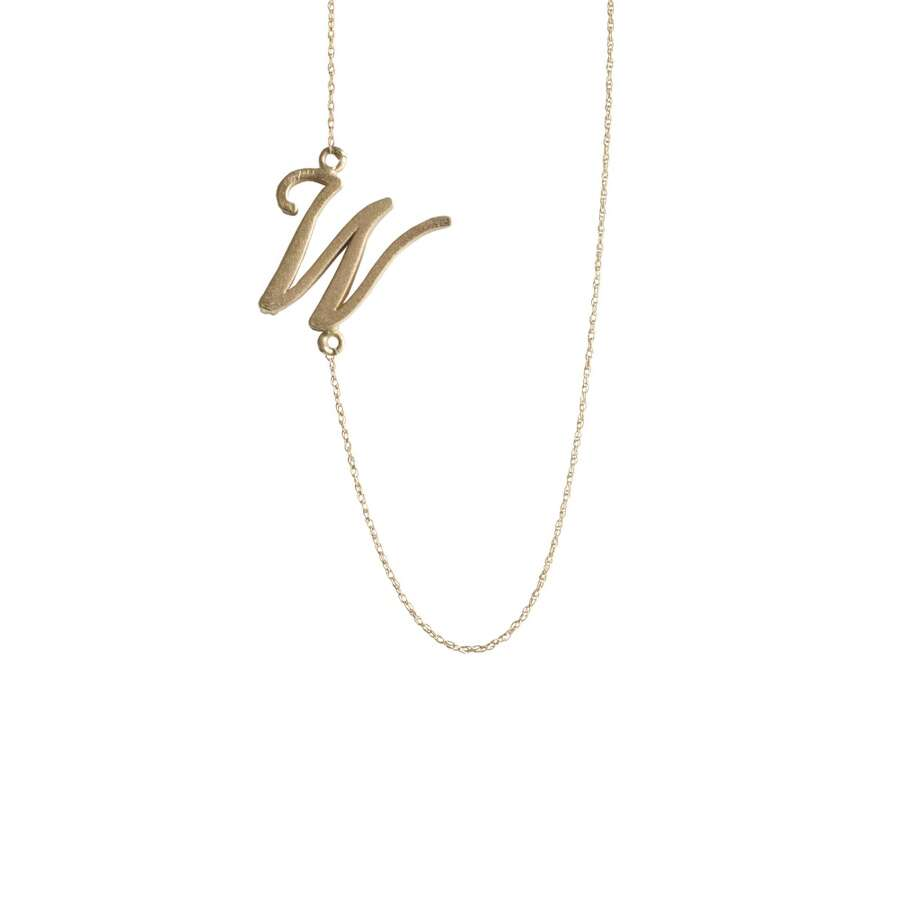 Golden Thread's monogrammed and charmed necklaces are perfect for layering