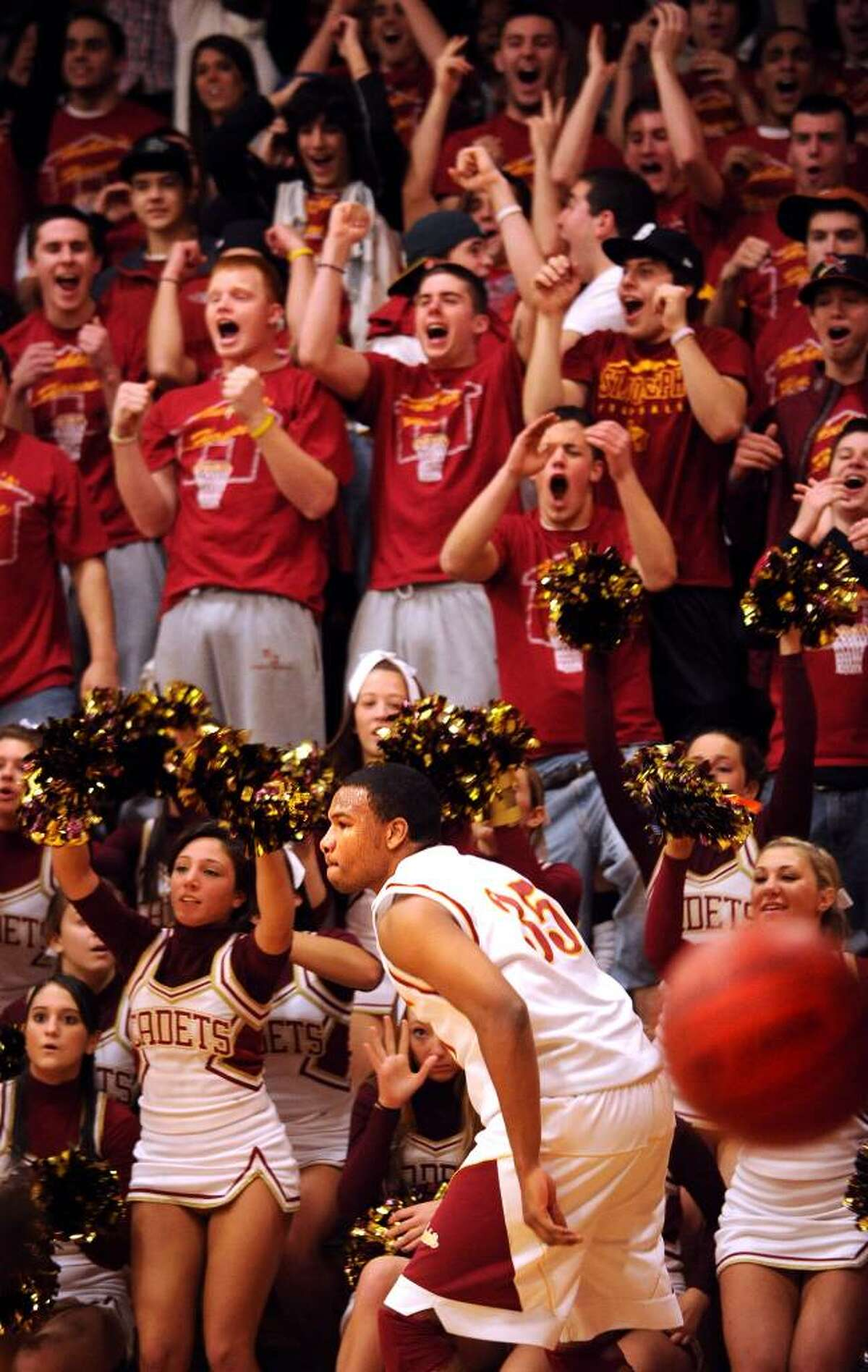 St. Joseph's Greg Langston runs past cheering fans after scoring his 1000th point in Tuesday night's game against Bassick Jan. 26, 2010 at St. Joseph High School in Trumbull.