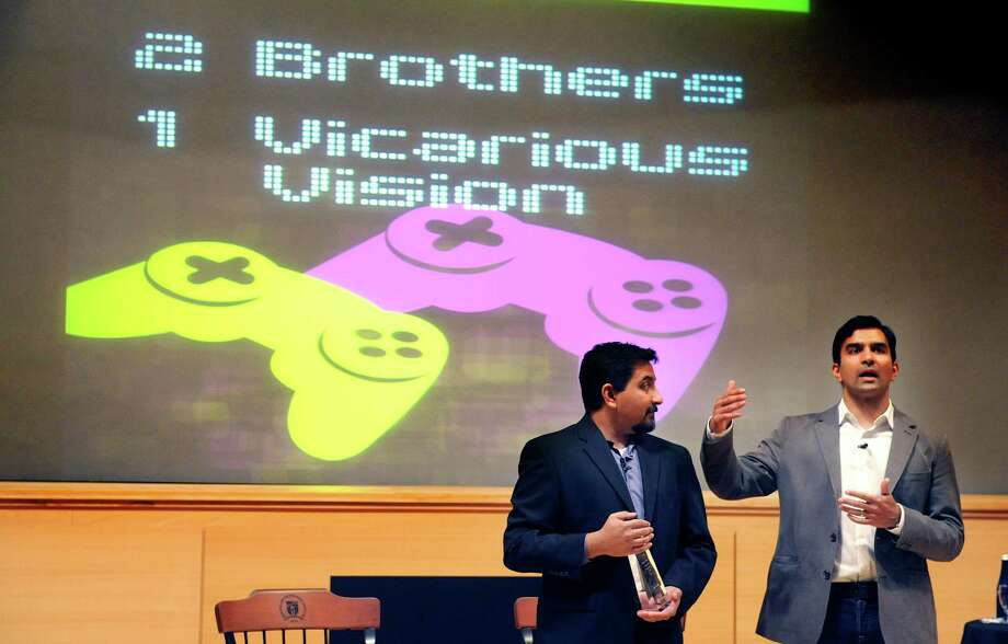 Vicarious Visions founders, Karthik Bala, left, and his brother Guha Bala, address those gathered after receiving their award during the 2013 William F. Glaser '53 Rensselaer Entrepreneur of the Year award program.  Karthik Bala is a member of the RPI class of 1997.   (Paul Buckowski / Times Union) Photo: Paul Buckowski / 00024179A