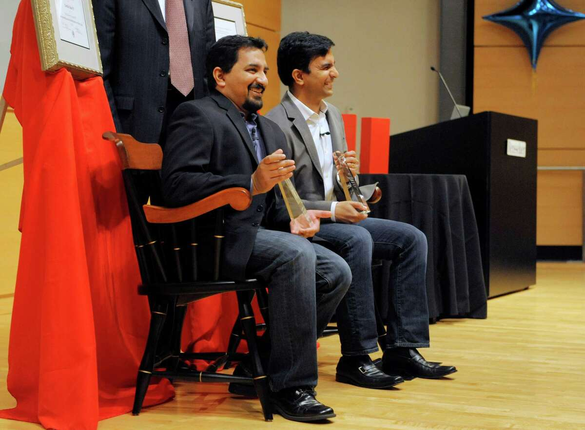 Vicarious Visions founders, Karthik Bala, left, and his brother Guha Bala, pose for photos Wednesday after receiving an honor at RPI's business school. When they started the video game business in the 1990s, cash was scarce, a problem many local start-ups still face in the Capital Region. (Paul Buckowski / Times Union)