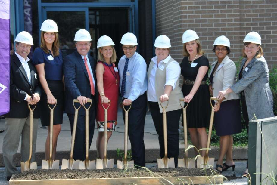 Board members held a ceremony at the future headquarters of The Houston and Southeast Texas Chapter of the Alzheimer's Association at 6055 S. Loop East on Oct. 9, 2013. Photo: Courtesy Photo