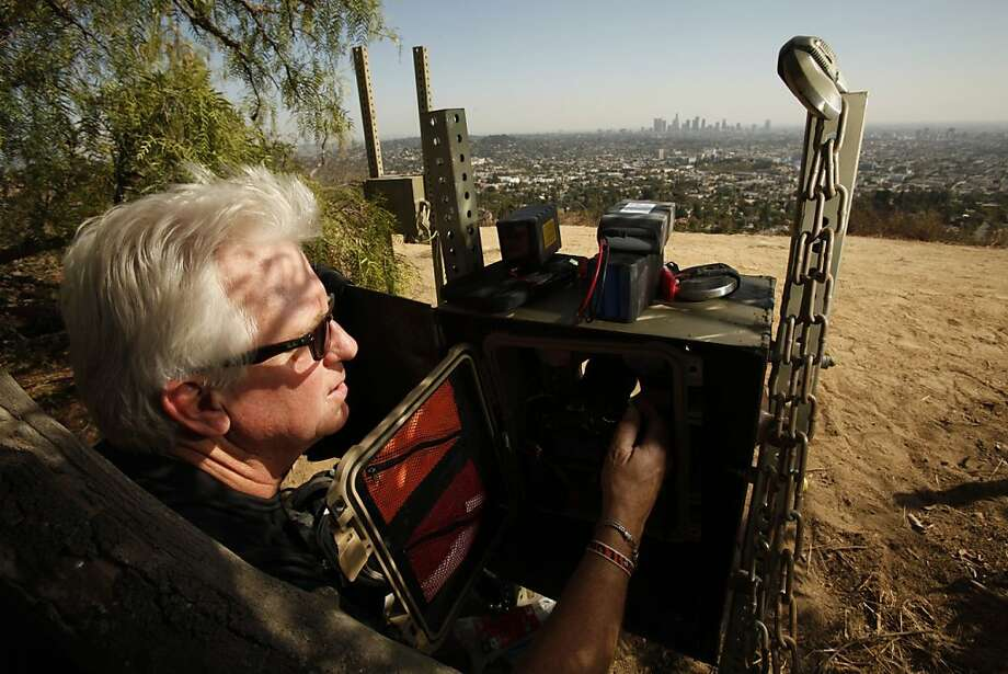 Photographer Steve Winter sets up a trail camera to capture images of P-22, a 4-year-old, 125-pound mountain lion living at Griffith Park in Los Angeles. Photo: AL Seib, McClatchy-Tribune News Service