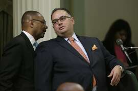 Assembly Speaker John Perez, D- Los Angeles, right, talks with Assemblyman Reginald Jones-Sawyer, D-Los Angles, as the Assembly debated a compromise plan, carried by Perez, to deal with the state's prison crisis, in Sacramento, Calif., Wednesday, Sept. 11, 2013.  The bill, SB105, a plan asking federal judges to extend the deadline for releasing thousands of inmates, combined with Gov. Jerry Brown's plan to lease cells in private prisons and county jails if the court sticks to its year-end deadline to reduce the inmate population, was approved 75-0 and sent to the Senate.(AP Photo/Rich Pedroncelli)