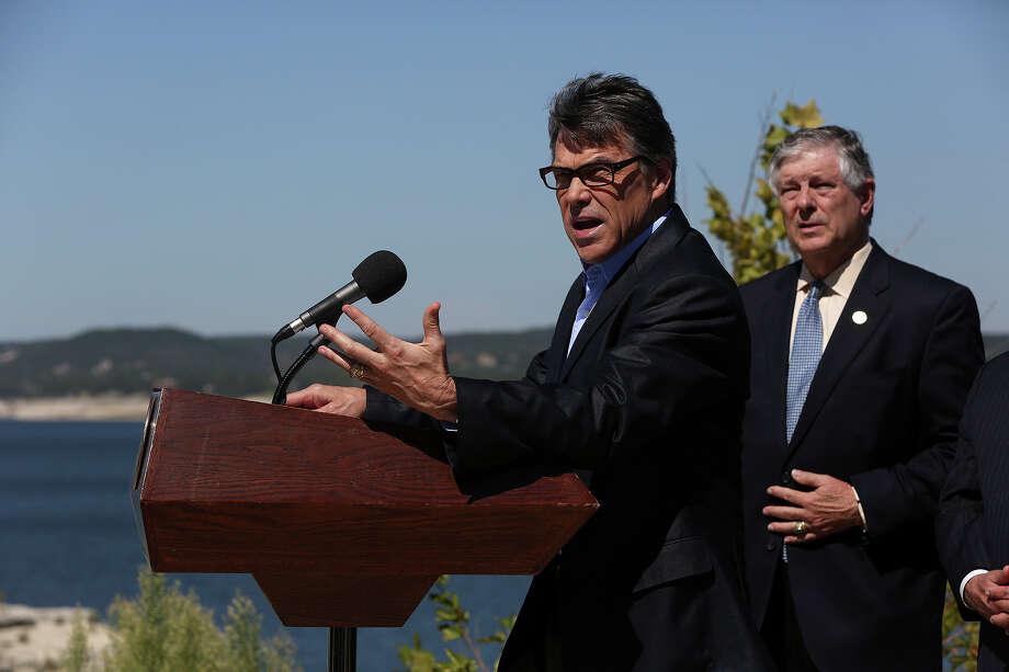 Texas Gov. Rick Perry addresses the media concerning Proposition 6 to promote the water plan on the Nov. 5 ballot. Photo: Lisa Krantz, San Antonio Express-News / San Antonio Express-News