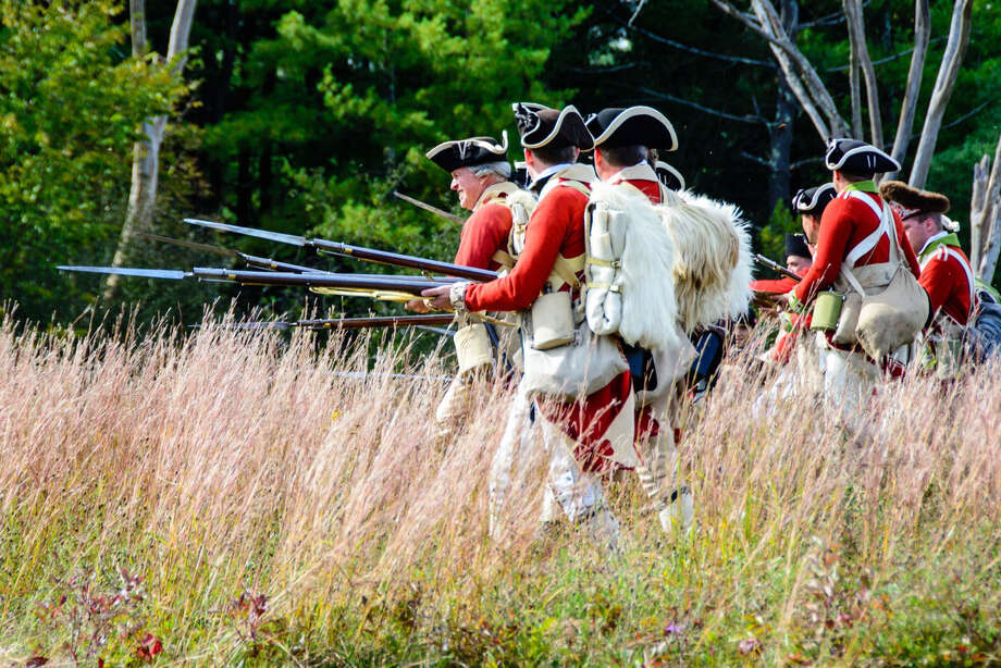 Revolutionary war re-enactors assemble on the battle field at Saratoga National Historic Park during an anniversary event to commemorate the park's 75th anniversary in September. (Dow Smith)