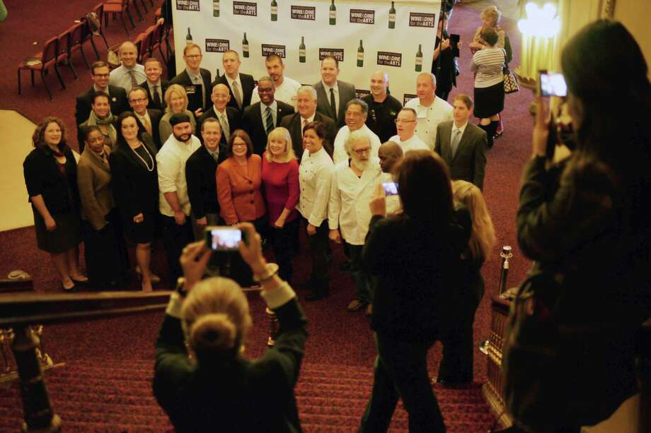 Area chefs, along with event organizers and city officials gather for a group photograph following a press conference at the Palace Theatre to announce details of 2014 Wine & Dine for the Arts festival on Wednesday, Oct. 9, 2013 in Albany, NY.    (Paul Buckowski / Times Union) Photo: Paul Buckowski / 00024193A