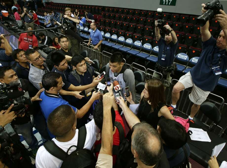 Rockets point guard Jeremy Lin talks with the media. Photo: Bullit Marquez, Associated Press