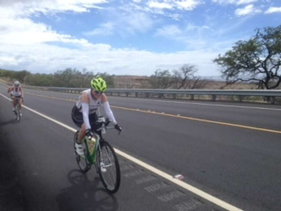 Christine McKnight, a retired UAlbany alumni magazine editor, does a training ride  in Kona, Hawaii, for the cycling portion of the Ironman Triathlon. (Jim McKnight)