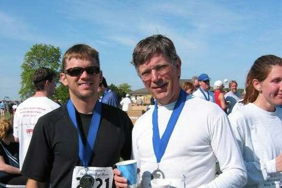 Chris Woll, left, with his late father, Eric Woll, at the 2006 Bay Bridge Run in Annapolis MD. Woll will participate in Houston's first Head for the Cure 5K in honor of his father, who died of brain cancer in 2011.