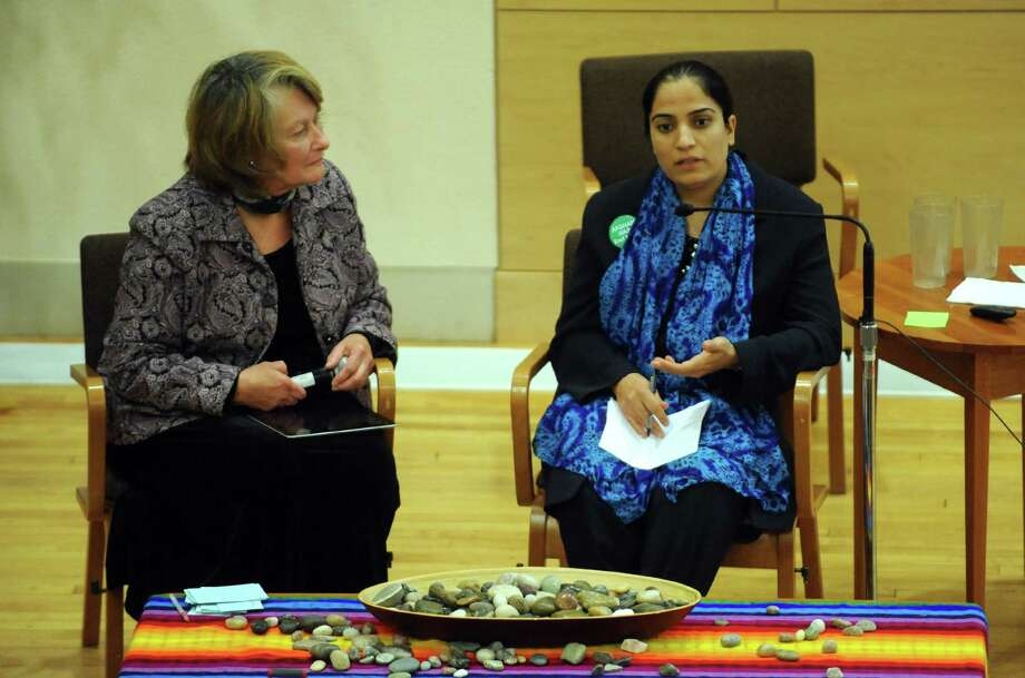 Maureen Aumand, left, moderates as Malalai Joya, right, activist and author speaks on Afghanistan at the First Unitarian Universalist Society of Albany on Wednesday Oct. 9, 2013 in Albany, N.Y. (Michael P. Farrell/Times Union) Photo: Michael P. Farrell / 00024157A