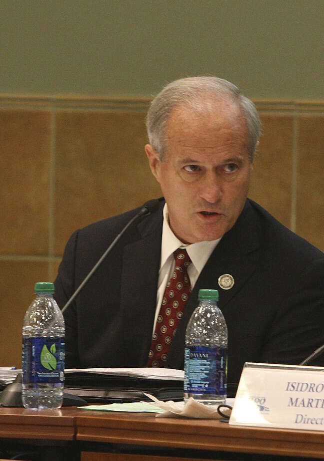 Commissioner Tommy Adkisson, seen here at a 2012 MPO meeting, says his emails are private, even those on public transportation policy. Photo: For The San Antonio Express-News