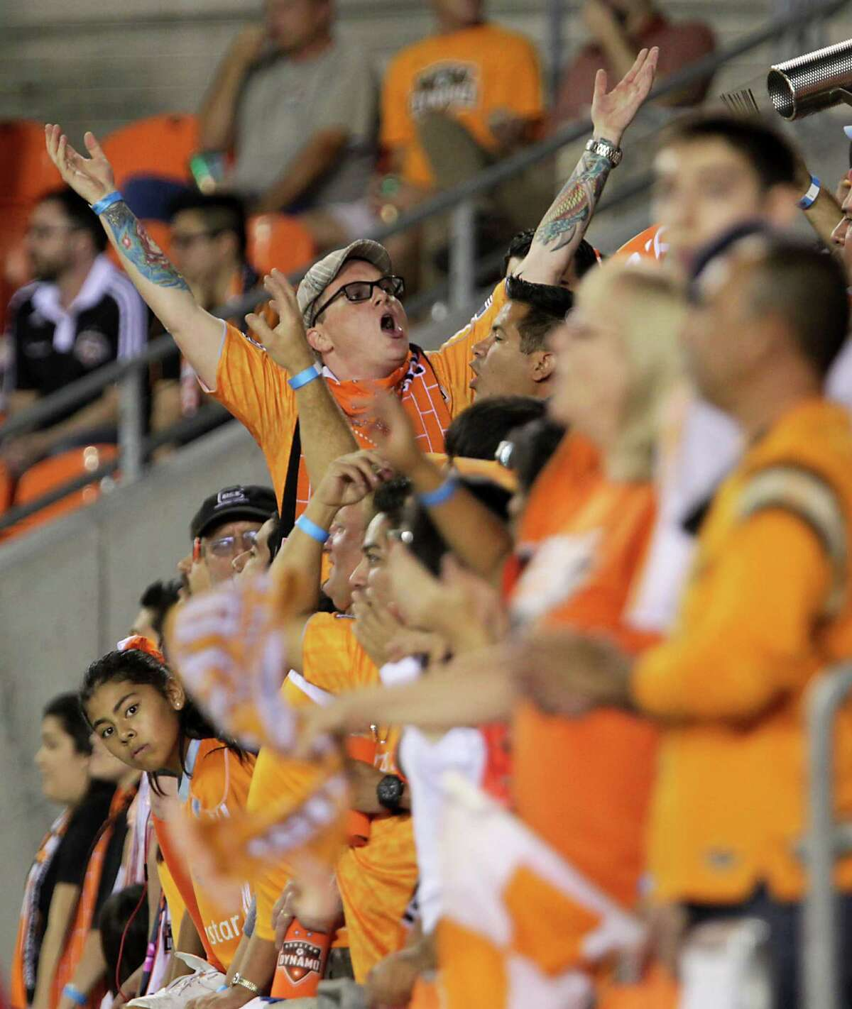 Houston Dynamo fans cheer as the Houston Dynamo play against the Sporting KC at BBVA Compass Stadium Wednesday, Oct. 9, 2013, in Houston.