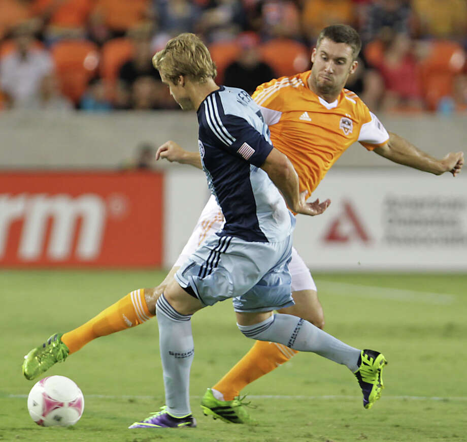 Sporting KC defender/midfielder Chance Myers left, and Houston Dynamo forward Will Bruin right, during the first half of MLS game action at BBVA Compass Stadium Wednesday, Oct. 9, 2013, in Houston. Photo: James Nielsen, Houston Chronicle / © 2013  Houston Chronicle