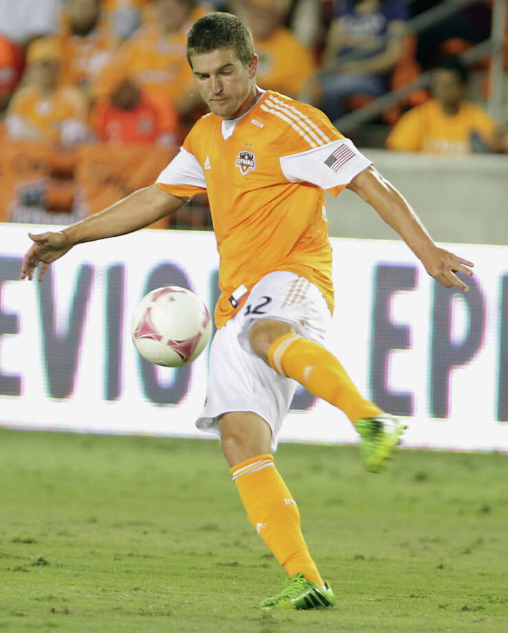 Houston Dynamo defender Bobby Boswell kicks the ball against the Sporting KC during the first half of MLS game action at BBVA Compass Stadium Wednesday, Oct. 9, 2013, in Houston. Photo: James Nielsen, Houston Chronicle / © 2013  Houston Chronicle
